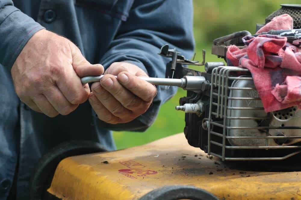 repairing broken used lawn mower