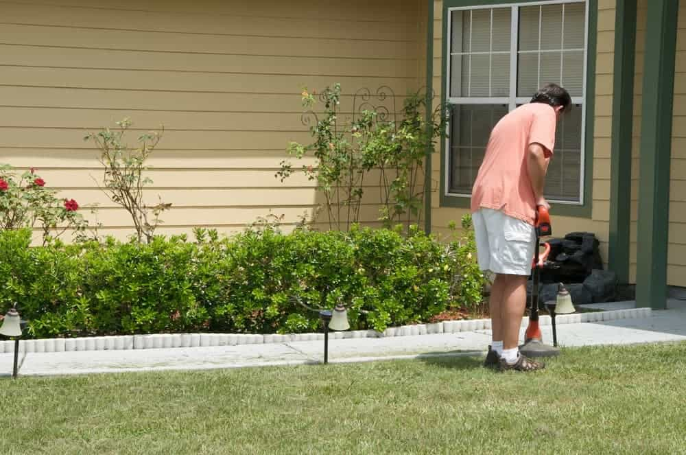 edging the lawn using string trimmer